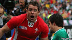 Shane Williams of Wales celebrates after scoring the opening try of the match. Photo: Getty Images. 2011 Ireland vs Wales QF at Rugby World Cup. source: http://www.smh.com.au/rugby-union/union-match-report/wales-storm-into-world-cup-semifinals-20111008-1letl.html
