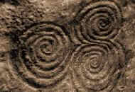 trispiral at Newgrange = source http://www.knowth.com/newgrange/spirals.jpg
